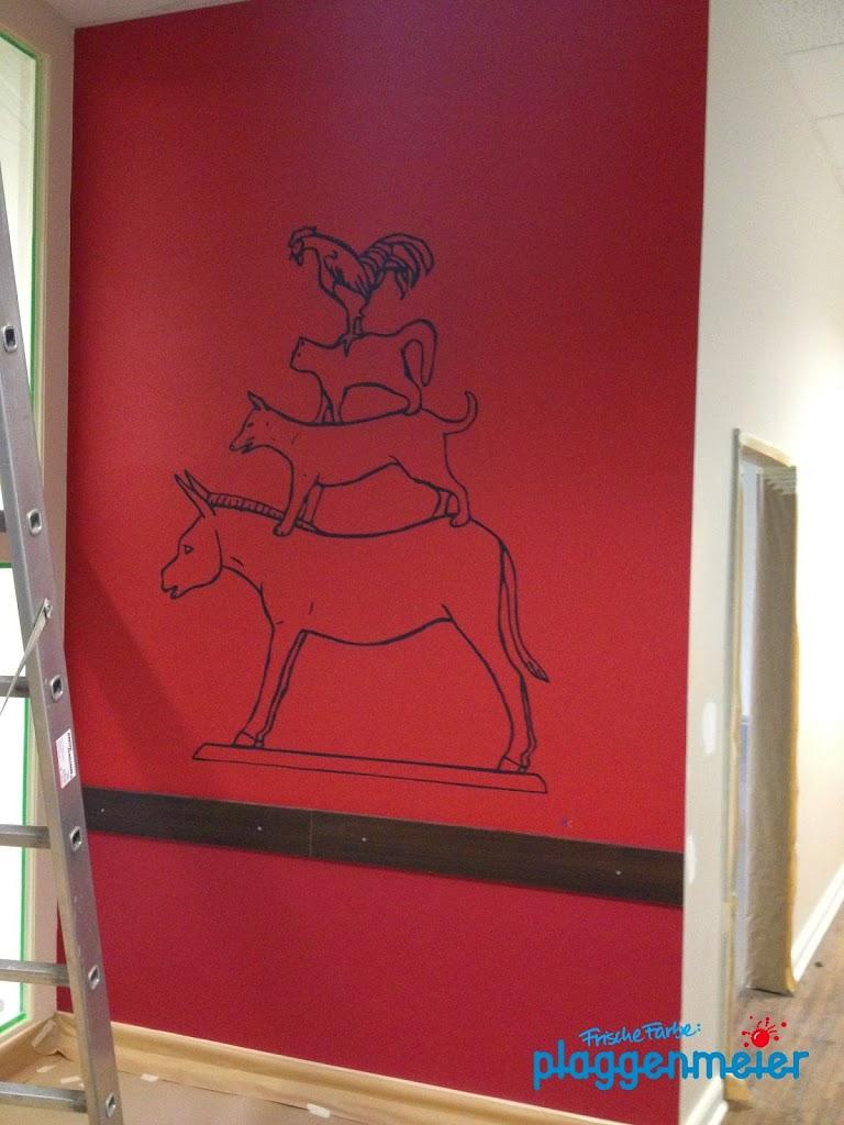 Von unserem Malergesellen gut geschützt: das Wandbild der Bremer Stadtmusikanten.