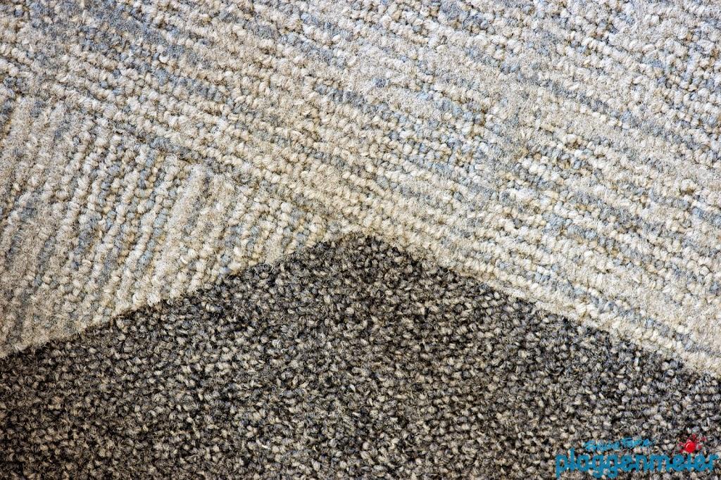 Exzellente Verleger für Teppichfliesen dieser Güte sind rar - es erfordert viel Erfahrung diese Oberfläche präzise zu gestalten.